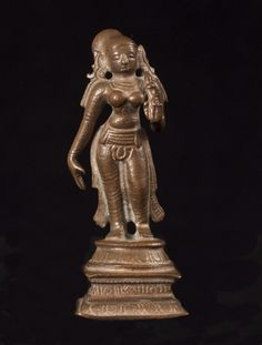 """Asian Tribal Art - Radha, lover of Krishna. 2 3/4 """" (7 cm) high. 17th century.  Radha was a one of the gopis (milkmaids or cowherds) who Krishna played and danced with as a child. They developed a divine love and she became his favorite. Some believe her to be an incarnation of Lakshmi and she embodies supreme focus and mental clarity, beauty, intelligence, and good fortune. #3515  $500"""