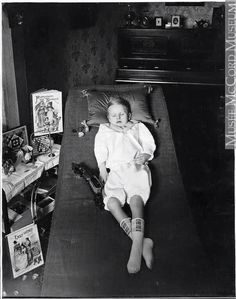 Victorian post mortem photo of a little boy surrounded by his favorite things in life. Memento Mori