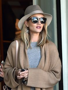 Rosie Huntington-Whiteley in long earrings - click through to shop 17 shoulder dusters for spring
