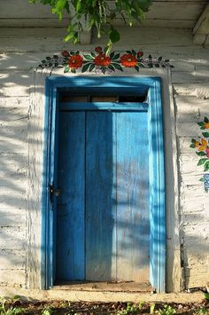 """The """"Painted Village"""" Zalipie, Poland photographed by Renata Helińska and Szymon Narożniak. The tradition of painting the houses in Zalipie dates back to the end of century. Famous Ceramic Artists, Polish Folk Art, Pantone 2020, Painted Doors, Painted Houses, Doorway, Play Houses, House Painting, Windows And Doors"""