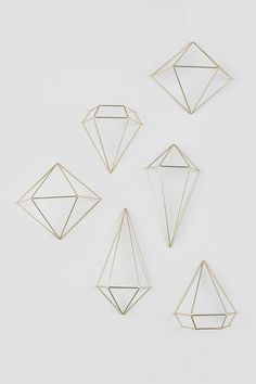 the gold prism wall decor features a set of 6 three dimensional geometric shapes that - Simple Shapes Wall Design 2