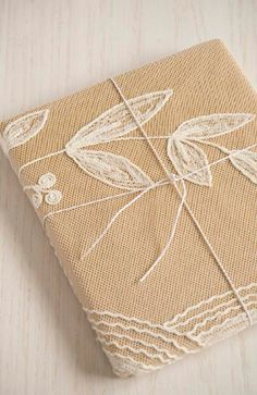 lace and craft paper wrapping. so lovely.