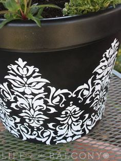Transform an old or inexpensive garden pot to create something very upscale, using paint and a stencil from the craft store!
