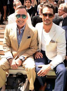 Sunny day: David sat next to David Furnish and both hid their eyes behind designer shades