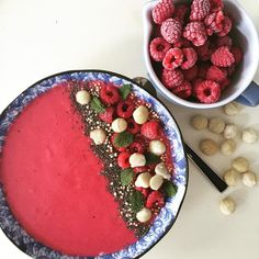Raspberry & Almond Milk smoothie bowl - the perfect start to the week ❤️ Blend 1 cup organic almond milk, 1 cup frozen organic raspberries, 1 organic banana and top with chia, mint, macadamia nuts and quinoa puffs