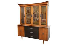 Betty would proudly display all her heirloom china in this cherry hutch.