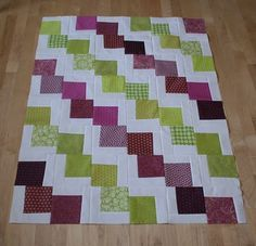 Quilt tutorial. Would be a great kids quilt from a charm pack. I also like the purple and green. Who would have guessed?