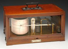 """A BAROGRAPH in mahogany outer case by Negretti & Zambra, London with carrying handle, 12"""" wide"""