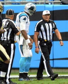 Carolina Panthers' Cam Newton (1) questions referee Ed Hochuli (85) about a non-call after being tackled by New Orleans Saints' Tyeler Davison (95) as during the second half of their game at Bank of America Stadium on Sunday, September 27, 2015. The Panthers won, 27-22.