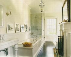 why not in the bathroom? framed prints lean on wide chair rail.