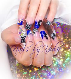 """""""Up in the Blue""""   I took my time with these babies. I did sculpted nails as usual I did royal blue with black glitter.I did zebra print with gorgeous two accent  fingers I'm loving this style"""