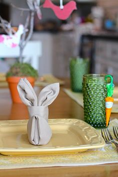 Folded Bunny Napkins + Lindt Chocolate Carrots. Great idea for Easter table decor!