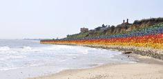 a virtual sea wall made of plastics washed up from the sea - protecting the sea from the land...
