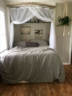 I like how and where the curtain is hung up too. Transformed small master bedroom into a roomy and cozy nook by putting the bed in the closet. Rustic Master Bedroom, Room Design Bedroom, Small Room Bedroom, Room Ideas Bedroom, Tiny Bedrooms, Bedroom Bed, Small Rooms, Bedroom Decor, Bed Room