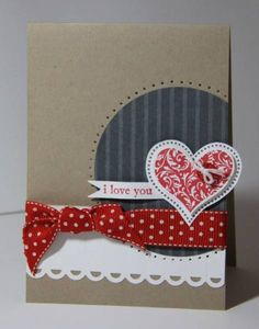 Paper piercing:  Use a needle to poke a hole into your card, make any shape you like.  On this handmade card, the technique is used to outline a circle and heart.  Also uses a red dotted ribbon and a red swirly heart.