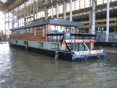 Houseboat custom designed by Dirkmarine. Build on a concrete hull