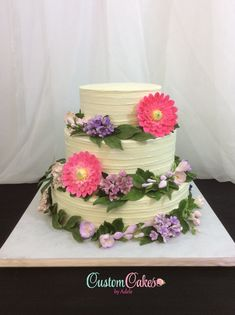 hot pink sugar dahlias and greenery on this wedding cake