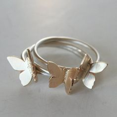 """I cut each butterfly out of brass by hand then texture and form each one, so they are all slightly different. Each one is individually soldered to its own handmade sterling silver ring. The rings can be worn all together or separate. <br /> <br /> The butterfly's are about 3/8""""."""