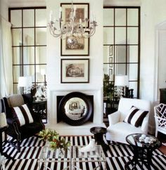 Stripes, Stripes, Stripes.    Black and white living room design. Lucite coffee table.