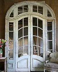 Love Architectural Elements. 1930's doors fitted w/mirrors and placed against a wall. A showstopper.