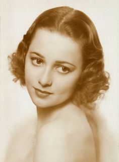 Olivia de Havilland, 1938 /****She always seemed so tragic, like such a victim. Perhaps it was just the roles they gave her, or perhaps that's how lots of women were in those days.