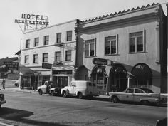 blackstone hotel... over Crocker Bank.  Corner of Chorro and Monterey... San Luis Obispo... and market... where the Sauer Bakery used to be... cool roof edge.  Tile under windows... cool striped awnings...  The county car parked out front with a porcelain county seal on the door...