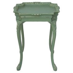 Wood end table with a removable tray top and hand-carved detail.    Product: End table   Construction Material:  Wood...
