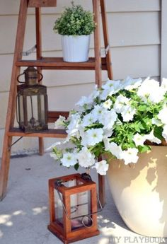You can't go wrong with lanterns and flower pots. They add some much needed warmth and personality to any outdoor patio space.