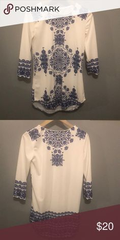 215d9187d43 Blue and white tunic top Very pretty floral  Greek inspired tunic top. Not  sheer at all. Worn 2-3 times with leggings and wedges. 3 4 length sleeves.