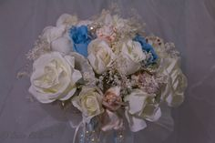 Bridal Bouquet of Silk and Dried Flowers and Seashells with Ribbons, Pearls and Crystals. $129.99, via Etsy.