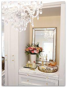 DIY Custom Closet Dressing Room | Crystal chandelier, view of built-in vanity | Vanity marble counter top styling Hermes perfume jewelry tray | Classy Glam Living
