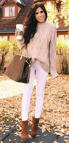 stylish babe wearing cable knit with white jeans