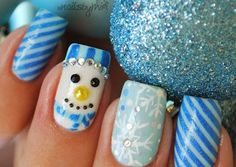 Chrismas Nail Art - Blue candy cane stripes with a snowman and snowflake design...x