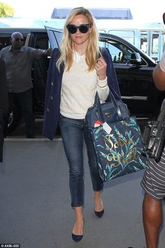 "Well-dressed: Reese Witherspoon carried a bag which read: 'Totes Y'All"" as she arrived at LAX on Wednesday"