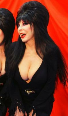 out Elvira boob popping