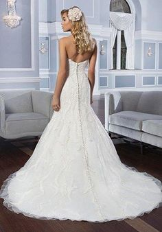 Beautiful and unique Fern Venice lace fit and flare wedding dress with a…