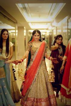 Gold bridal lehenga with coral dupatta and green blouse and a perfect dupatta drape!