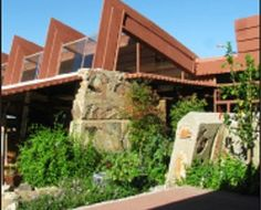 Frank Lloyd Wright's home - Taliesin West is open to the public. Young and old will enjoy touring this magnificent feat in architecture and learning how he used the resources available to him when building. #FrankLloydWright #Arizona #tourism #PlayRealNet