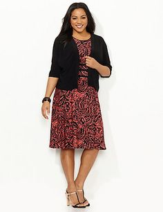 Dazzle in our scrolling jacket dress. The draped jacket has an openfront to effortlessly showcase the scoopneck dress below. An allover paisley print covers the dress, while solid bands at the empire waist emphasize your silhouette. Jacket has bust darts and three-quarter sleeves. Pull-on dress. Catherines dresses are expertly designed for the plus size woman. catherines.com