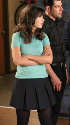 Zooey Deschanel's Mint green short sleeve sweater and black box pleated skirt on New Girl.  Outfit Details: http://wwzdw.com/z/4010/ #WWZDW