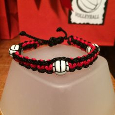 Volleyball square knot bracelet.. I made these for my daughters volleyball team. I put them inside the goodie bags.