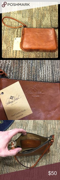 NWT Patricia Nash leather wristlet NWT Gorgeous cognac colored leather wristlet by Patricia Nash.  There is faux fur along the edges for a beautiful and fun additional feature.  Two internal pockets.  7 inches x 4.25 inches.  Super soft leather! Patricia Nash Bags Clutches & Wristlets