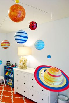 Planet mobile (from pottery barn) combined with a fun orange rug (from west elm)!