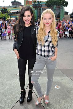 Sofia Carson and Dove Cameron of Disney's 'Descendants' perform and join fans at Downtown Disney at Disneyland Resort on October 17, 2015 in Anaheim, California.