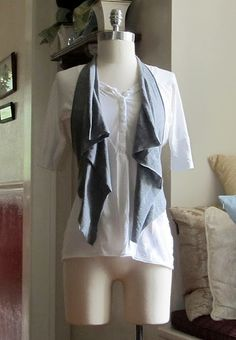 No sew T-shirt vest. There is even a longer version on the website and step instructions on how to do it. Super easy and so cute, I'm so gonna try this, I've always wanted a vest like this but could never find one or afford one now I can make my own :)