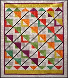 UP THE DOWN STAIRCASE--  This quilt is made from an assortment of Polka Dots and our original pattern, Up the Down Staircase.