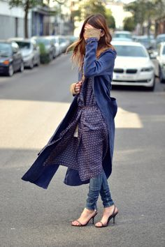 Layers. Modest way to wear jeans is with a wrap around dress. Love this style