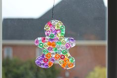 Beads, cookie cutters, glue.. and a great sun catcher!