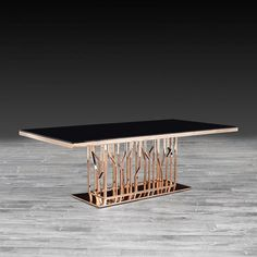 a3c687e76e41e5 Lorensia Rectangular Luxury Dining Table features a rose gold polished s. steel  base with black
