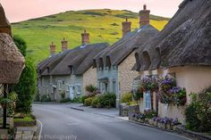 Lulworth, Dorset, England We LOVE England A beautiful row of cottages greets each visitor heading down this hill towards Lulworth Cove. Not a bad introduction to a beautiful village along the Jurassic Coast of southern England